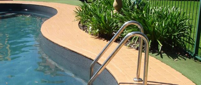 Coping of Domestic pool painted with Luxapool_poolside and paving Arnhem Colour