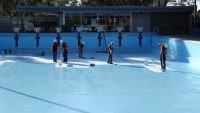 The Pool Painters team applying the first coat of LUXAPOOL Epoxy in Pacific Blue.