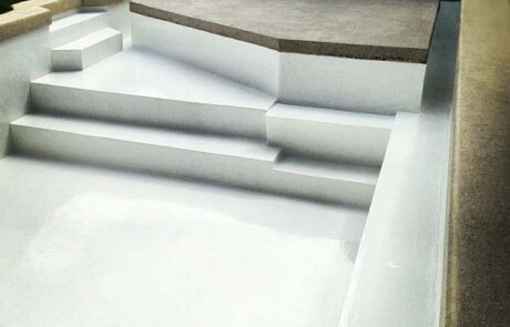 Concrete pool painted with Luxapool pool paint white