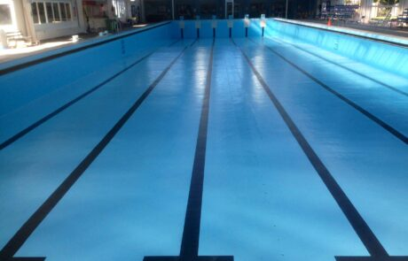 North Bondi olympic-size pool without water painted with Luxapool epoxy pacific blue