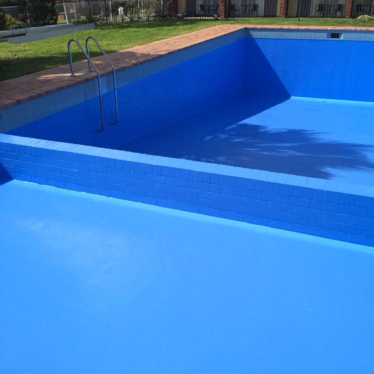 Motel pool resurfaced in luxapool epoxy in tahitian for Epoxy pool paint