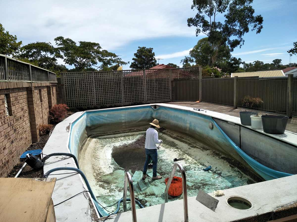 Preparing a domestic pool before renovation where pool coping will be updated with LUXAPOOL Poolside & Paving