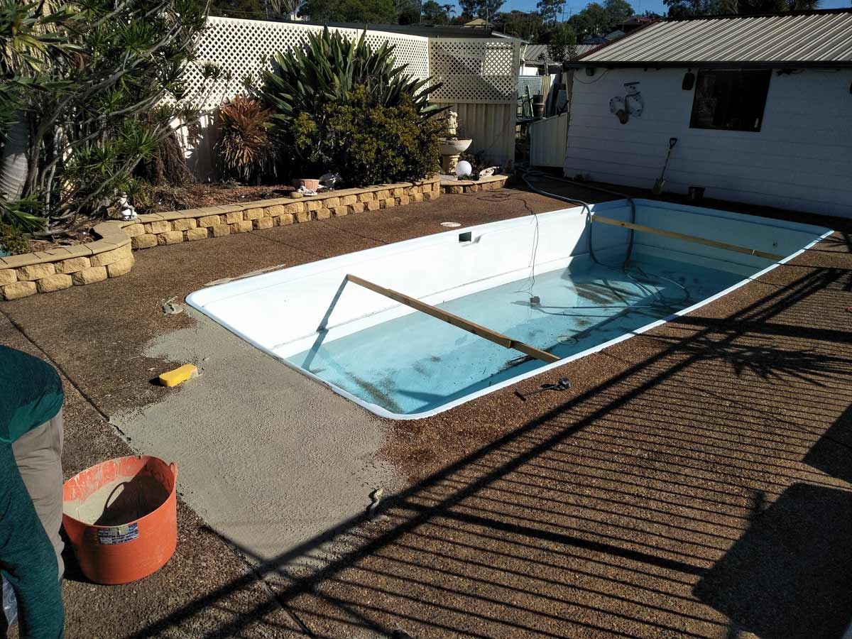 BEFORE - Preparing a residential pool, cement rendering over the Pebblecrete pool surrounds before then painting over the top with LUXAPOOL poolside & paving