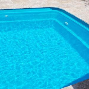 Residential pool painted in LUXAPOOL Epoxy Turquoise_colour by DIYer Timothy Grant with the water in