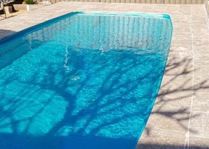 Residential pool painted in Luxapool epoxy turquoise colour in partial shade