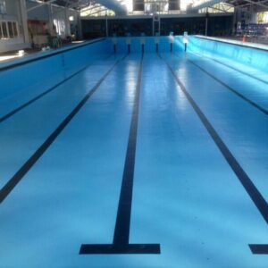 Indoor Olympic Pool painted in LUXAPOOL Epoxy Pacific Blue