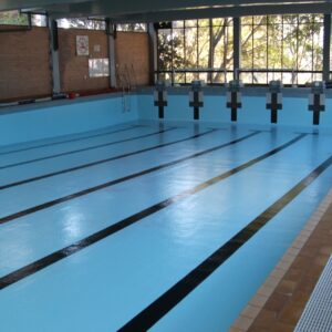 Wenona School Pool was painted in LUXAPOOL Epoxy Pacific Blue with Black for the lane lines